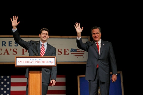 File photo of House Budget Chairman Ryan introducing U.S. Republican presidential candidate Romney as he addresses supporters at Lawrence University during a campaign stop in Appleton