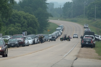 Vehicles lining Cty Rd BE at USAIR event in Shawano, WI